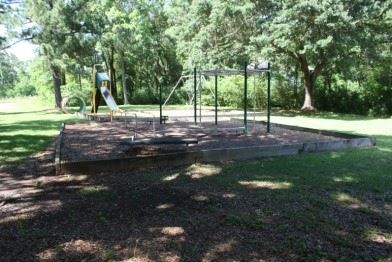 Image of swingset in Dutch Bayou Road Park