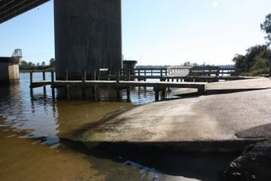 Image of boat launch under an overpass of Highway 63