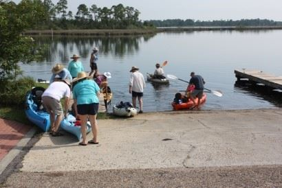 Image of people loading into canoes and kayaks at the Riverfront Boat Launch
